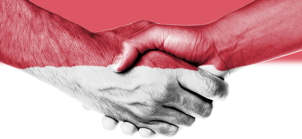 Picture of hand shaking themed with Indonesia flag clolors